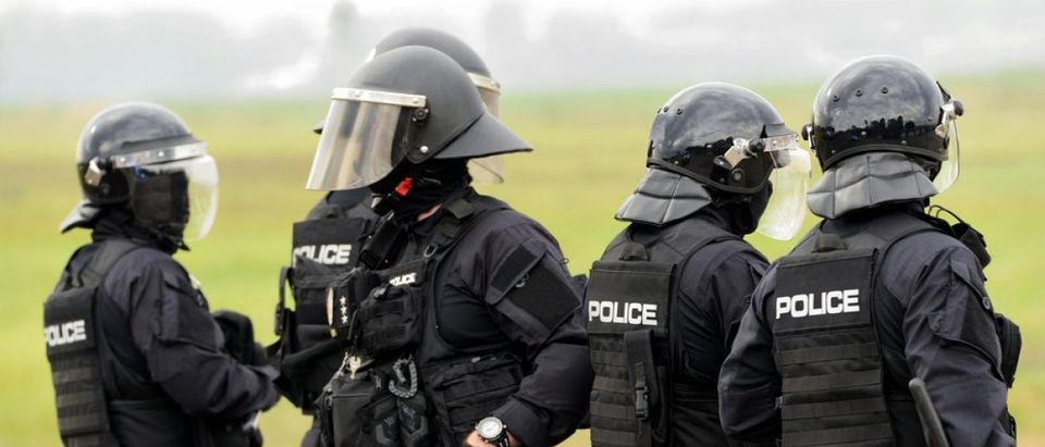 A police SWAT team on standby. (Photo: whitelook/Shutterstock)