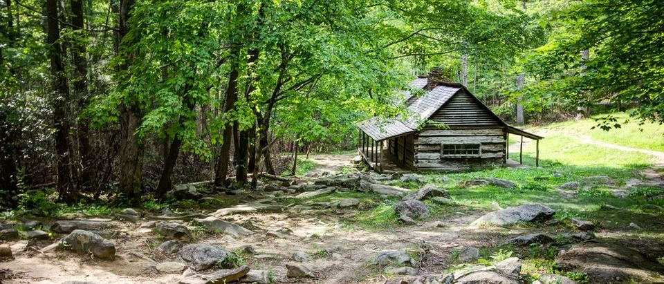 Pioneer Log Cabin. Log cabin in a lush mountain valley in the Great Smoky Mountains National Park. (Photo via Shutterstock)