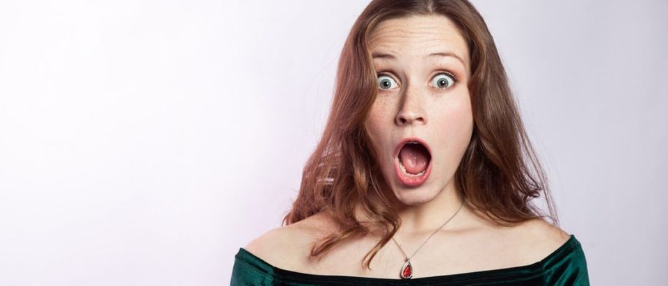 Surprised woman (Shutterstock/Khosro)