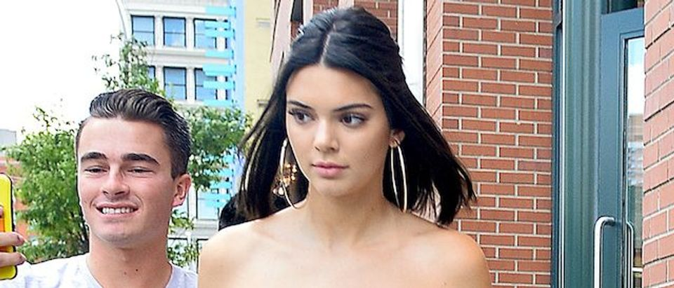 Kendall Jenner looks striking in a floral cropped dress as she heads to a Polo game in NYC