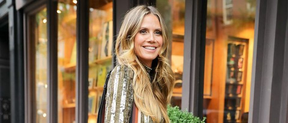Heidi Klum wore a mini gold dress while arriving at her book signing in New York City