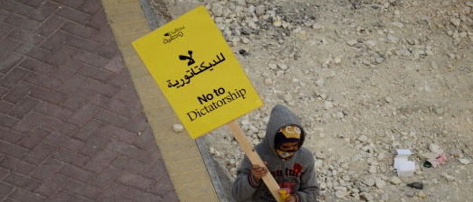 A Bahraini Shiite Muslim protester walks