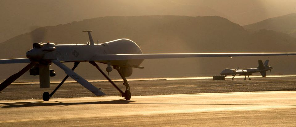 An MQ-1B Predator, left, and an MQ-9 Reaper taxi to the runway in preparation for takeoff June 13, 2014, at Creech Air Force Base, Nev. The aircraft are assigned to the 432nd Wing, which trains pilots, sensor operators and other remotely piloted aircraft crewmembers, and conducts combat surveillance and attack operations worldwide. (U.S. Air Force photo by Airman 1st Class Christian Clausen/Released)