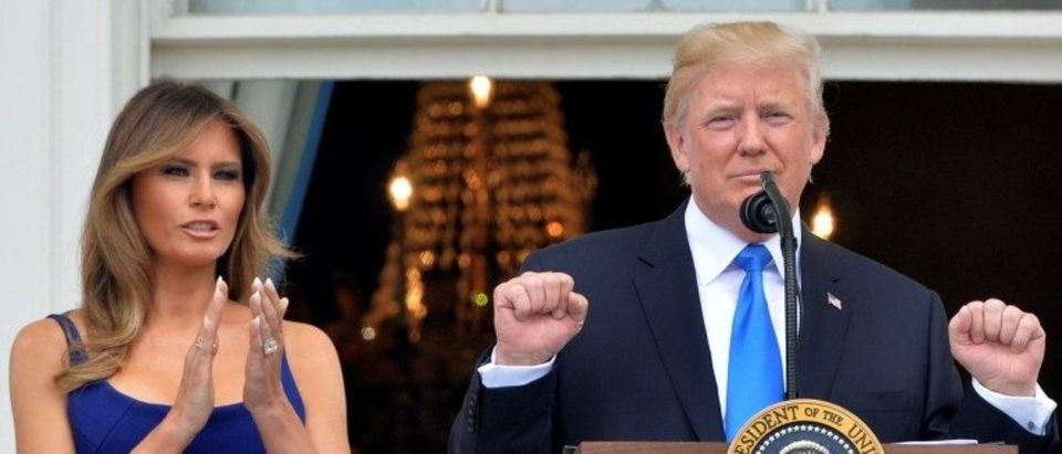 President Donald Trump concludes his remarks while First Lady Melania Trump applauds as they welcome military families in Washington