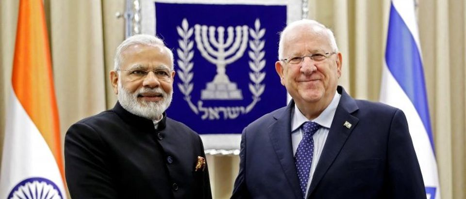 Israeli President Reuven Rivlin shakes hands with Indian Prime Minister Narendra Modi at the president's official residence in Jerusalem