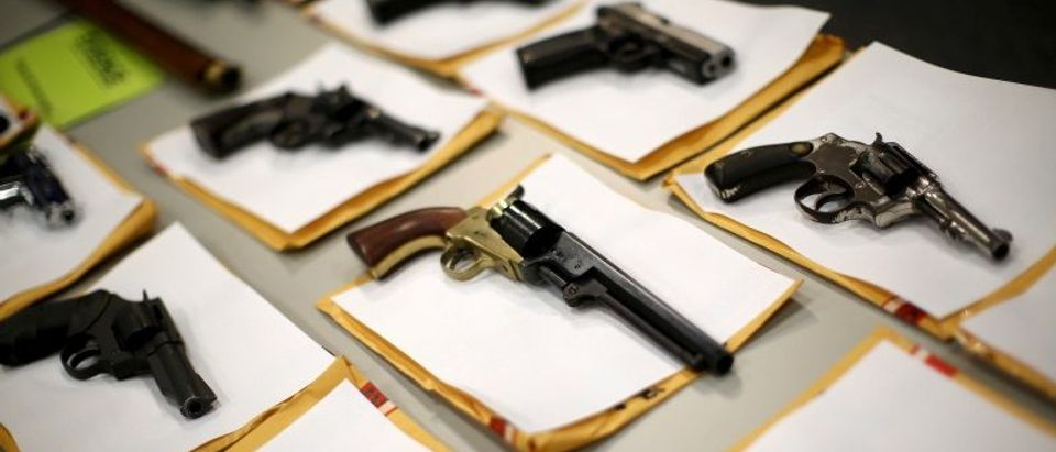 FILE PHOTO: Some of the guns seized over the last week are seen on display at the Chicago Police Department in Chicago