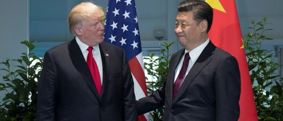 U.S. President Donald Trump and Chinese President Xi Jinping (R) meet on the sidelines of the G20 Summit in Hamburg, Germany, July 8, 2017. REUTERS/Saul Loeb, Pool