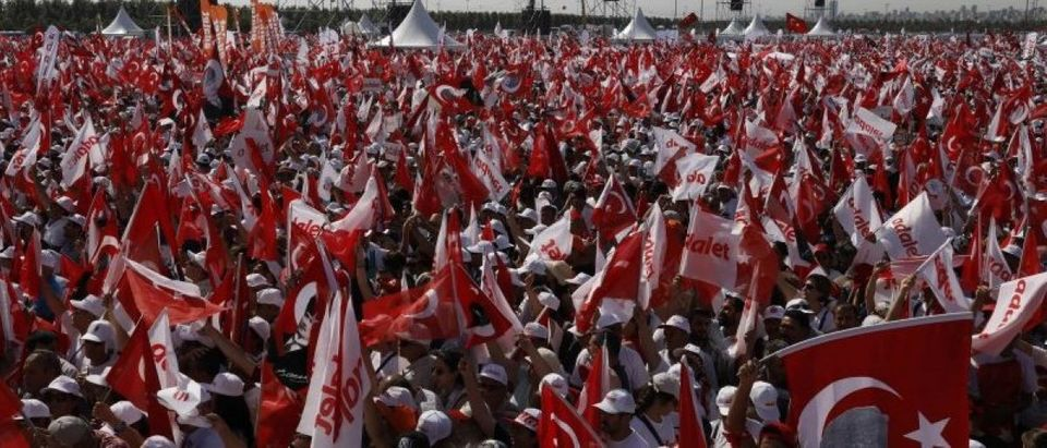 """People wave Turkish flags during a rally to mark the end of the main opposition CHP leader Kilicdaroglu's 25-day long protest, dubbed """"Justice March"""", against the detention of the party's lawmaker Berberoglu, in Istanbul"""