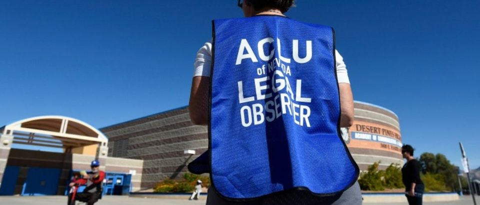 FILE PHOTO - A member of the ACLU observes a polling station during voting in the 2016 presidential election in Las Vegas