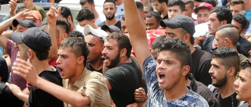 Palestinian mourners attends the funeral of Saad Salah and Aws Salameh in the West Bank city of Jenin