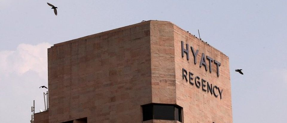 Birds fly past the Hyatt Regency hotel in New Delhi