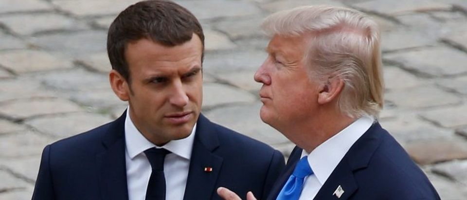 French President Emmanuel Macron and US President Donald Trump attend a welcoming ceremony at the Invalides in Paris