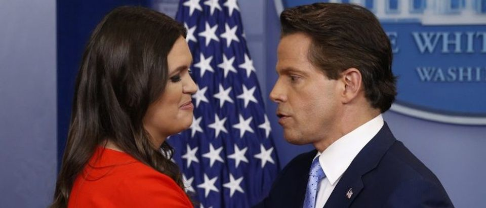 White House Press Secretary Sanders greets new White House Communications Director Scaramucci during the daily briefing at the White House in Washington