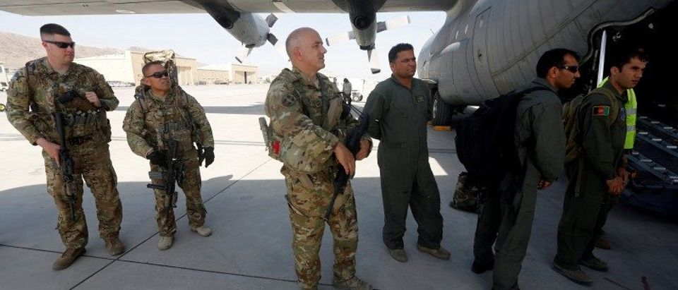 U.S. and Afghan air crew prepare for a flight at the Kabul military airport in Kabul