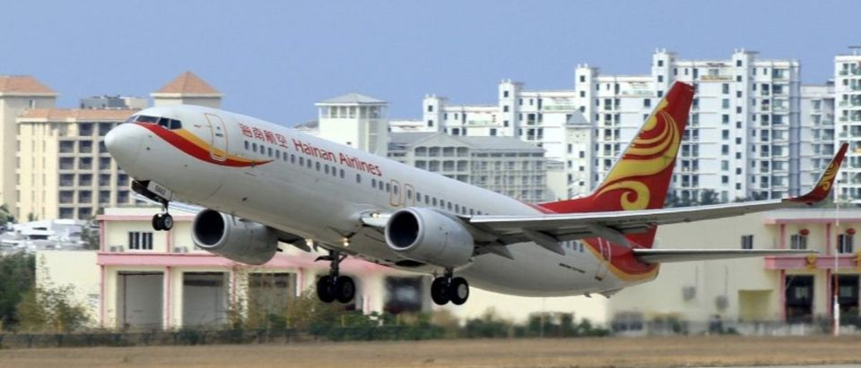 FILE PHOTO: A Hainan Airlines plane takes off from the Sanya Phoenix International Airport in Sanya