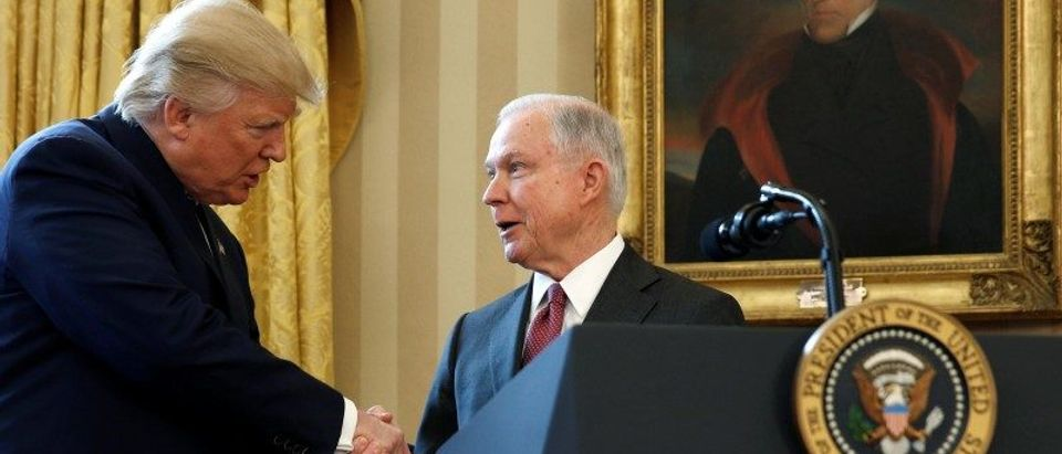 FILE PHOTO - President Trump congratulates new U.S. Attorney General Sessions after being sworn in at the White House in Washington