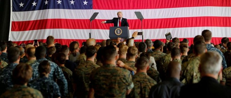 FILE PHOTO: U.S. President Donald Trump delivers remarks to U.S. military personnel at Naval Air Station Sigonella following the G7 Summit, in Sigonella