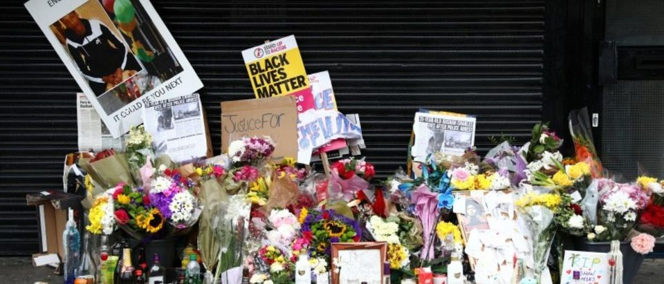 Floral tributes are left after the death of Rashan Charles outside a shop in east London, Britain July 29, 2017. REUTERS/Neil Hall