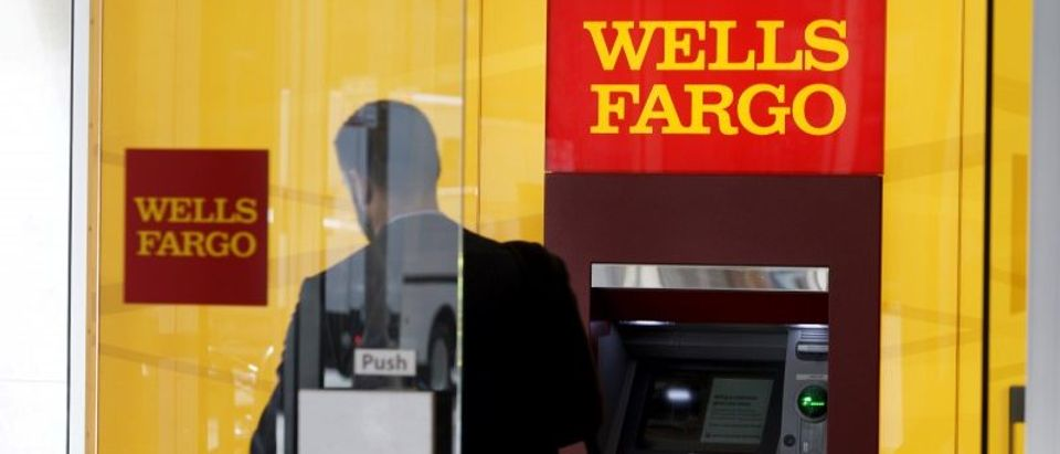 FILE PHOTO - A man walks by a bank machine at the Wells Fargo & Co. bank in downtown Denver