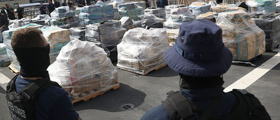 FORT LAUDERDALE, FL - DECEMBER 15: Security personnel from the U.S. Coast Guard ship Hamilton guard the approximately 26.5 tons of cocaine on the deck of the ship at Port Everglades on December 15, 2016 in Fort Lauderdale, Florida. The drugs worth an estimated $715 million were from 27 separate, suspected drug smuggling vessel interdictions and five bale recovery operations by the U.S. Coast Guard, Royal Canadian Naval crews and its interagency partners. (Photo by Joe Raedle/Getty Images)