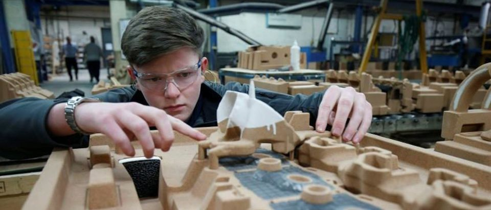 Apprentice Ryan Hickman works with a sand mould of a car engine ready for casting at GW cast in Bridgnorth