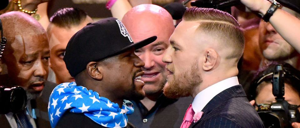 Floyd Mayweather Jr. and Conor McGregor stand face to face during the Floyd Mayweather Jr. v Conor McGregor World Press Tour at Staples Center on July 11, 2017 in Los Angeles, California. (Photo by Harry How/Getty Images)