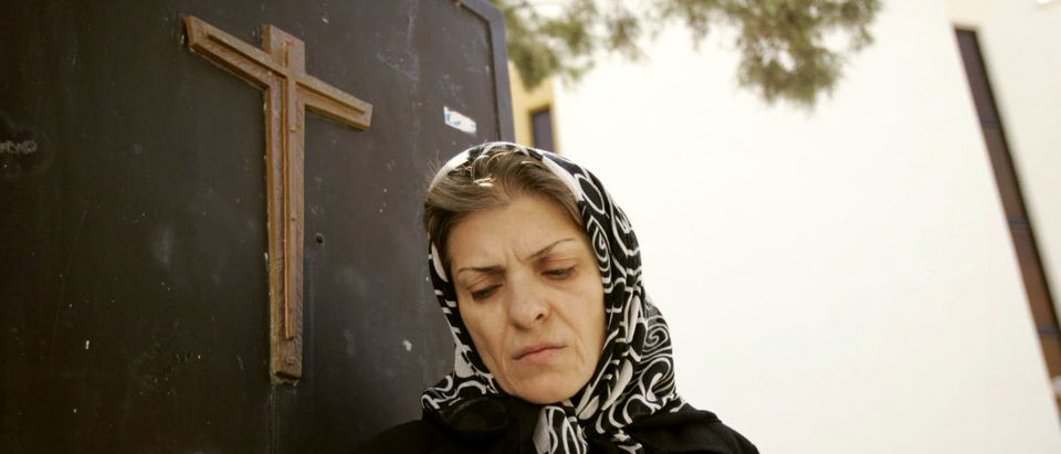Iranian Christian woman leaves church after prayer ceremony in Tehran