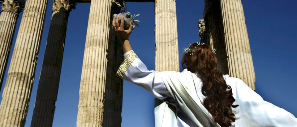 A priestess dances as she participates in a rare ceremony honoring Zeus in Athens