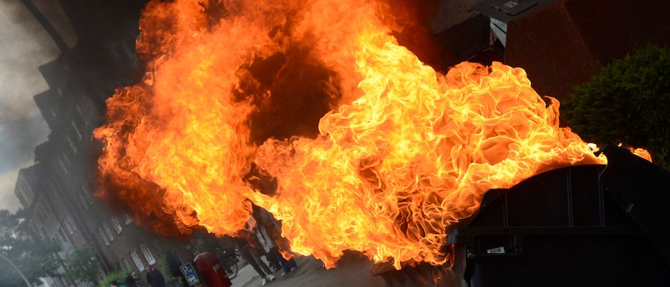 Burning street barricades are pictured during a demonstration of right-wing extremists in downtown Hamburg, northern Germany on June 2, 2012. Several thousands residents demonstrated against the march of the right-wing extremists