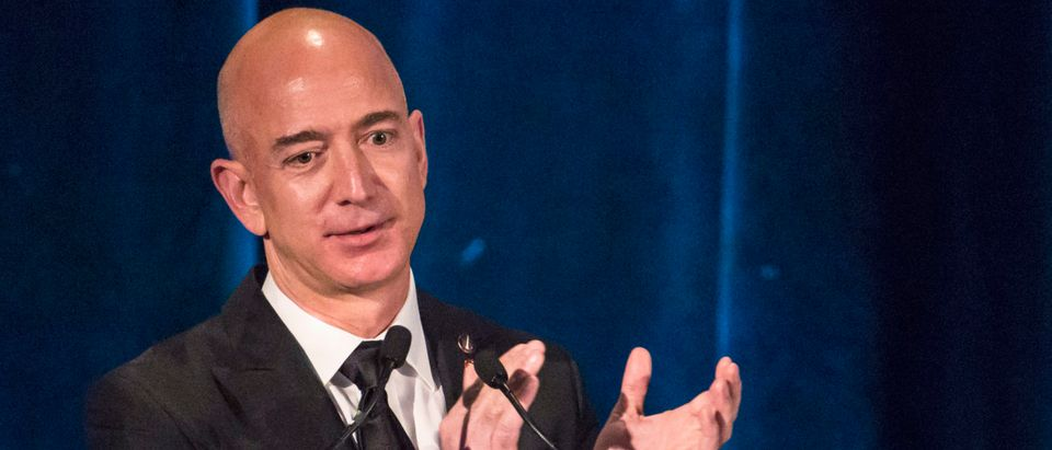 Amazon CEO and Chairman Bezos receives the Citation of Merit on behalf of the Apollo F-1 Search and Recovery Team at the 110th Explorers Club Annual Dinner in New York
