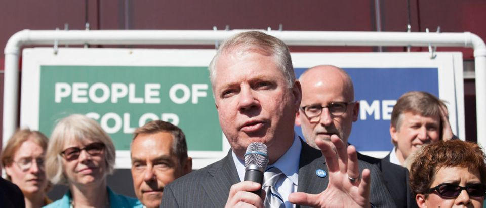 Mayor Ed Murray addresses the crowd during a rally at City Hall after a Seattle City Council meeting in which the council voted on raising the minimum wage to $15 per hour in Seattle, Washington