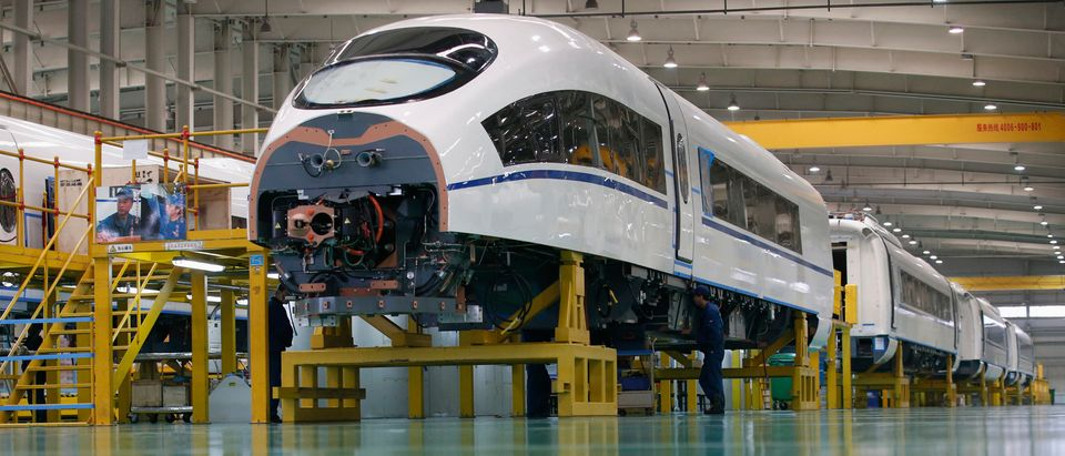 An employee works on a high speed train model CRH380B at a final assembly line of China CNR's Tangshan Railway Vehicle's factory in Tangshan, Hebei province