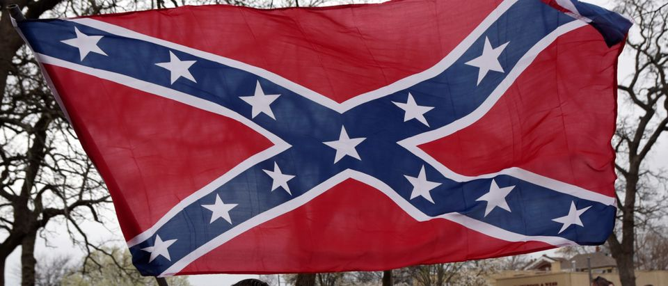 Confederate battle flag hoisted during a rally held by Sons of Confederate Veterans in Shawnee, Oklahoma, U.S. March 4, 2017. REUTERS/Nick Oxford - RTS11GY4