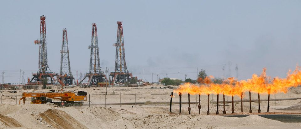 Flames emerge from a pipeline at Rumaila oilfield in Basra