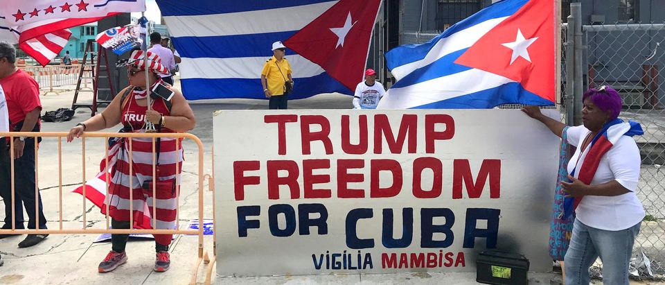 Lacayo, (L) and Jimino, both of Miami, show their support for U.S. President Donald Trump near the Manuel Artime Theater in Miami