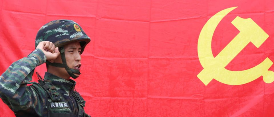 A Chinese paramilitary policeman takes an oath ahead of the 96th anniversary of the founding of the Communist Party of China (CPC) in Kunming, Yunnan province, China, June 30, 2017. Picture taken June 30, 2017. REUTERS/Stringer
