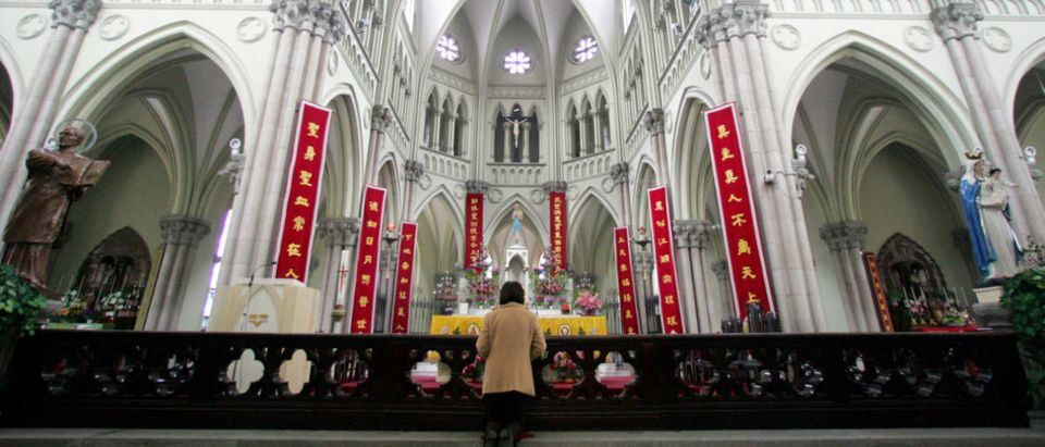 A Chinese Catholic prays on Easter Sunday at Saint Ignatius Cathedral in Shanghai.