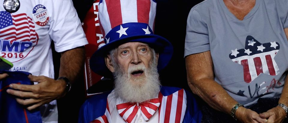A man dressed as Uncle Sam sits in the audience at a Trump campaign rally in Prescott Valley, Arizona. (Photo: REUTERS/Mike Segar)