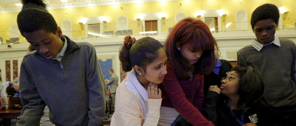 High school students from the City on a Hill Charter Public School play the role of U.S. senators as they work to pass an immigration reform bill during a mock legislative session of the U.S. Senate chamber at the Edward M. Kennedy Institute in Boston, Massachusetts June 10, 2015. Opened in March, the institute was imagined by the late Democrat, who died in 2009, as a place that could rekindle lost respect for a stalled Senate. The Kennedy Institute also hosts the only full-scale replica of the U.S. Senate chamber, where school groups might be awed not only by the grandeur of the room, but by the potential of the people inside it to chart the nation's future. Picture taken June 10, 2015. REUTERS/Brian Snyder