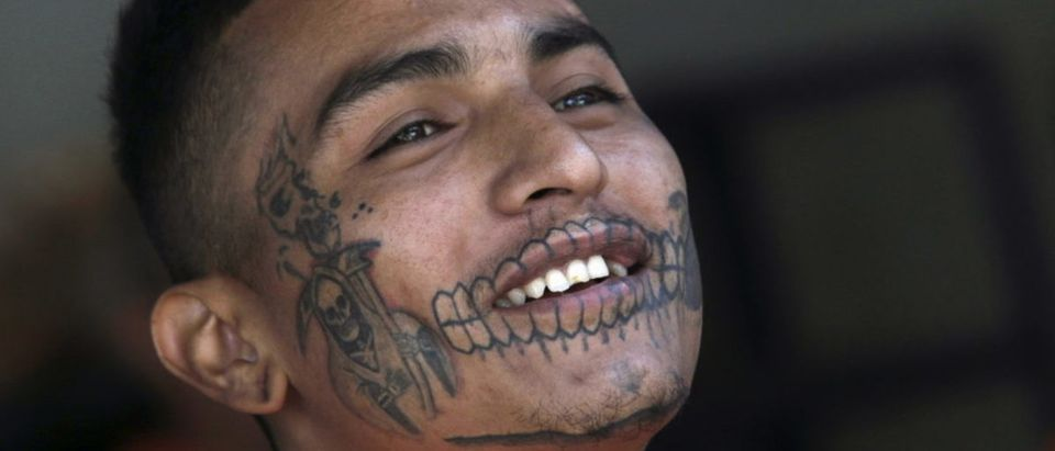 An inmate with a tattoo of Santa Muerte reacts in the Topo Chico prison, during a media tour, in Monterrey