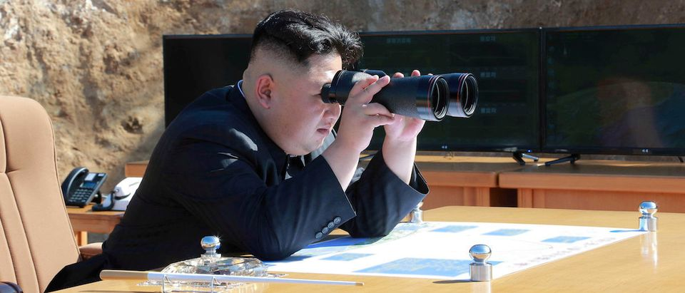 North Korean Leader Kim Jong Un looks on during the test-fire of inter-continental ballistic missile Hwasong-14 in this undated photo released by North Korea's KCNA in Pyongyang