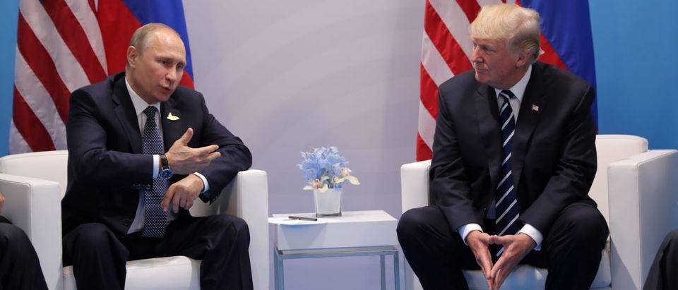 Russia's President Vladimir Putin talks to U.S. President Donald Trump during their bilateral meeting at the G20 summit in Hamburg