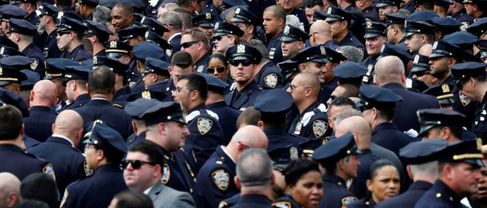 Police officers gather for the funeral service for slain New York City Police Department (NYPD) officer Miosotis Familia in the Bronx borough of New York City, U.S., July 11, 2017. REUTERS/Brendan McDermid