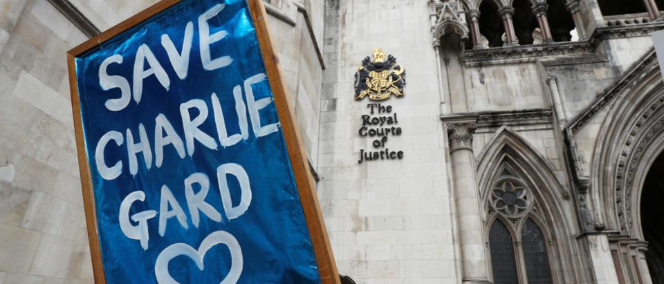 People campaign to show support for allowing Charlie Gard to travel to the United Stated to receive further treatment, outside the High Court in London