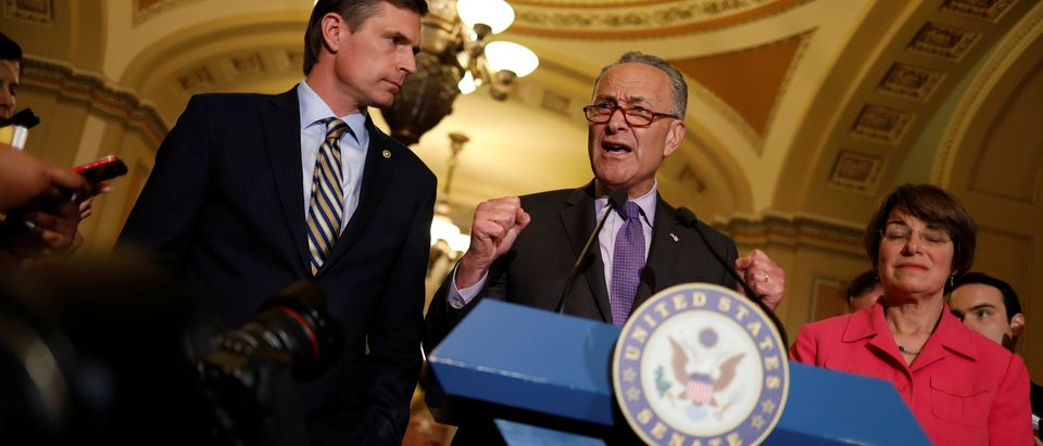 Senate Minority Leader Chuck Schumer, accompanied by Senator Martin Heinrich (D-NM) and Senator Amy Klobuchar (D-MN), speaks with the media about the recently withdrawn healthcare bill on Capitol Hill in Washington, U.S., July 18, 2017. (Picture: REUTERS/Aaron P. Bernstein)