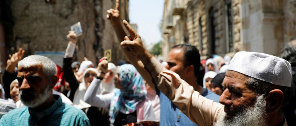 Palestinians shout slogans during a protest over Israel's new security measures at the compound housing al-Aqsa mosque, known to Muslims as Noble Sanctuary and to Jews as Temple Mount, in Jerusalem's Old City
