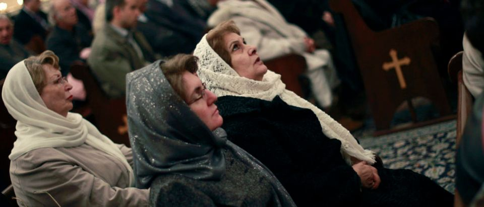Christian women attend a New Year mass at Saint Serkis church in central Tehran January 1, 2011. New Year is celebrated by the Assyrian and Armenian minorities in Iran, where a majority of its citizens are Muslim. REUTERS/Morteza Nikoubazl (IRAN - Tags: RELIGION SOCIETY) - RTXW4J2