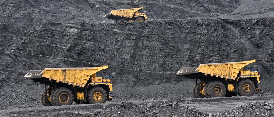 Dump trucks in a coal mine.