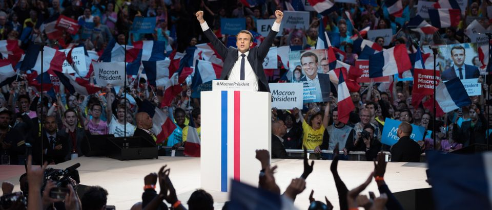 Shutterstock/ PARIS, FRANCE - APRIL 17, 2017 : Emmanuel Macron in meeting, the great gathering, at Paris Bercy, AccorHotels Arena, for the french presidential election of 2017 with his political party en marche.
