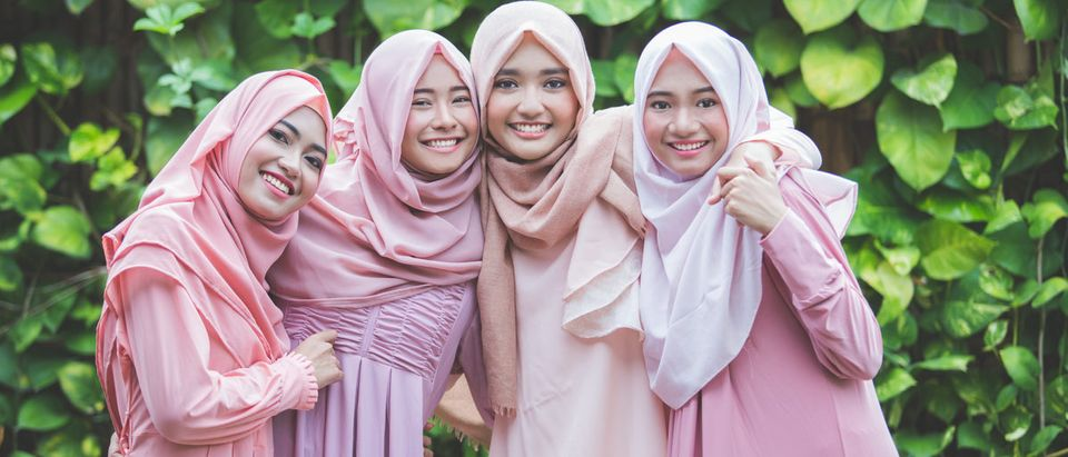 Shutterstock/ portrait of happy group of pretty girl best friends together. muslim woman concept wearing hijab or head scarf